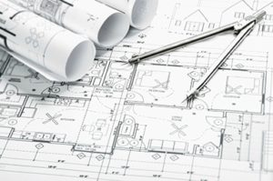 Design documents and blueprints with compass for contractors.