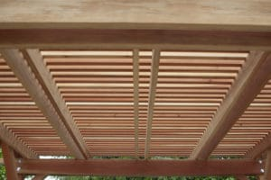 Close look at the redwood member of the pergola that produce its wonderful shade.