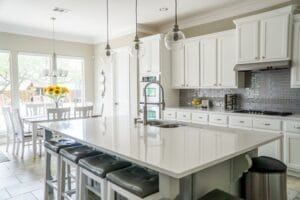 Kitchen Remodel in Sacramento with large white island.