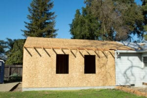 Side view of a new attached garage built by Hartigan Construction