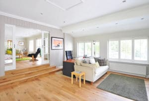 Modern renovation with wood floors, can lights and bright window light.