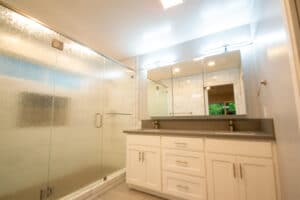 bathroom with white subway tile and shower door
