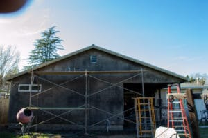 brown coat stucco on gable end of room addition